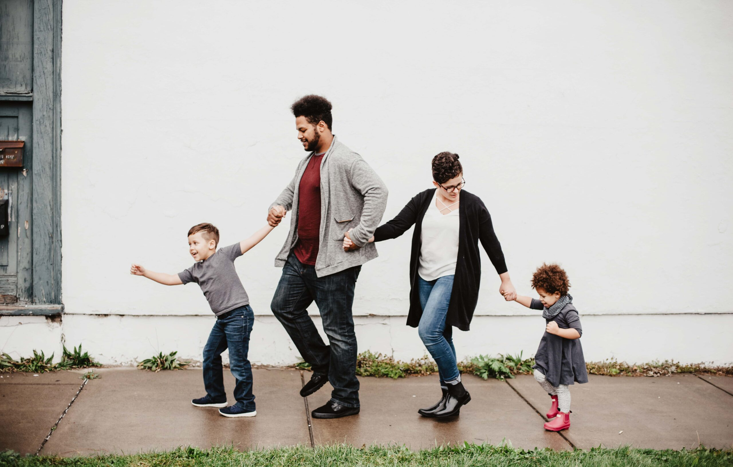 Two Foster parents take a walk with their newly adopted kids