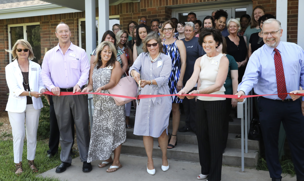 EmberHope Youthville staff and Newton Chamber conduct a ribbon cutting of a new PRTF home to a pilot program for non-custody at-risk families